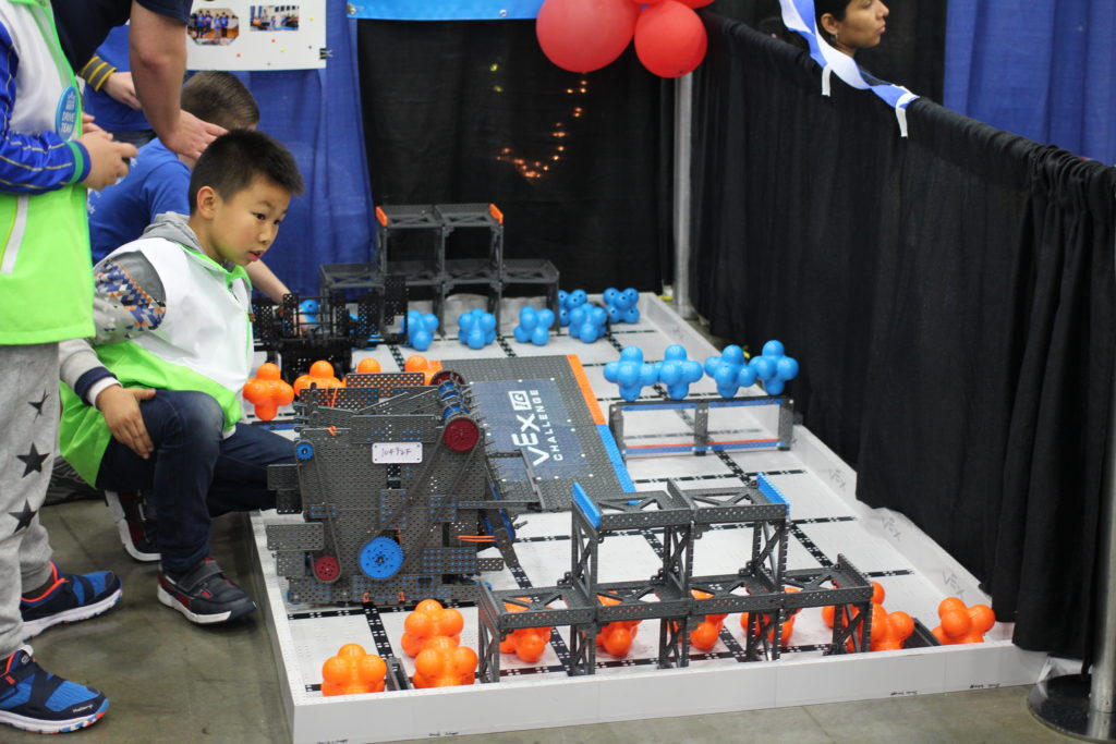 Robotics student and robot